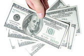 One Hundred Dollars in hand — Stock Photo
