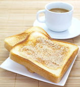 Slice of grilled bread and coffee — 图库照片