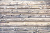 Wooden wall of a log house — Stock Photo