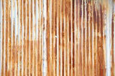 Rusting metal fencing or siding — Stock Photo