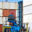 Stock Photo: Forklift is stacking container