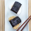 Stock Photo: Japanese food Onigiri rice ball and eat with chopsticks