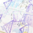 Immigration arrival stamps on passport — Stock Photo #40795399