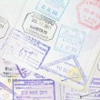 Stock Photo: Immigration arrival stamps on passport