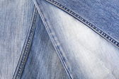 Lot of different blue jeans — Foto de Stock