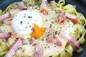 Pasta Carbonara with ham and cheese — Stock Photo