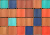 Stack of containers shipping at dockyard — Stock Photo