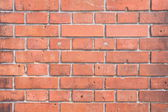 Red brick wall surface with cement — Stock Photo