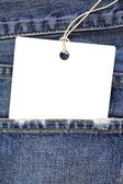 Blue jeans with blank label — Stock Photo