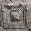 Detail of carved wooden door - Stock Photo