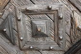 Detail of carved wooden door — Stock Photo