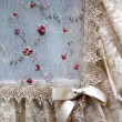 Foto Stock: Old embroidered curtain