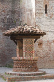 Old well in the castle — Stock Photo
