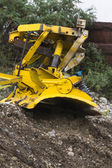 Bulldozer in the mountains — Stock Photo