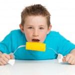 Boy eating corn on cob — Stock Photo