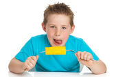 Boy eating corn on cob — Stock Photo