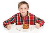 Boy eating pork pie — Stock Photo