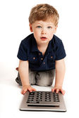 Cute boy counting with calculator. — Stock Photo