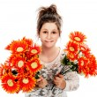 Teenage girl holding two bunches of fake flowers. — Stock Photo