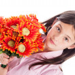 Young Girl Holding a Bunch of Flowers. — Stock Photo #28740073