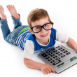 Stock Photo: Geeky Boy Smiling with Big Claculator.