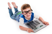Geeky Boy Smiling with Big Claculator. — Stock Photo