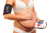 Pregnant Woman Taking Her Blood Pressure. — Stock Photo
