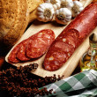 Stock Photo: Spanish Chorizo on Timber Board