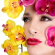 Stock Photo: Beautiful Girl With Orchid Flowers. Makeup.
