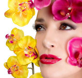 Beautiful Girl With Orchid Flowers. Makeup. — Stock Photo