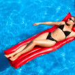 Stock Photo: Bronzed. Beauty Brunette Sunbathing in Pool