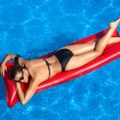 Stock Photo: Beauty Brunette Sunbathing in Pool