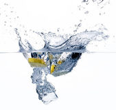 Healthy Water with Lemon. Splashing — Stock Photo