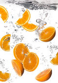 Healthy Water with Fresh Oranges. Drops — Stock Photo