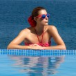 Beauty Bronzed. Poolside Girl. Woman in Red — Stock Photo #30860197