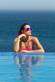 Bronzed Beauty. Poolside Girl. Woman in Red — Stock Photo