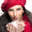 Beautiful Christmas Girl Blowing Snow — Stock Photo