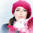 Beautiful Winter Woman in red Blowing Snow — Stock Photo #36190725