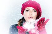 Beautiful Winter Woman in red Blowing Snow — Stock Photo