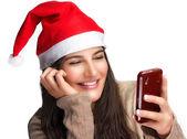 Christmas Girl with Christmas Gift. Mobile Phone — Stock Photo