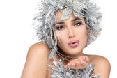 Christmas girl sending a kiss. Fashionable woman portrait with Silver Stylism. Vogue style mode — Stock Photo