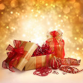 Christmas Gifts and Decorations in Gold and Red — Stock Photo