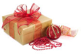 Christmas Gift Box and Decorations in Gold and Red — Stock Photo