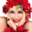 Stock Photo: Joyful Christmas Girl with Beauty Floral Wig. Holiday Hairstyle