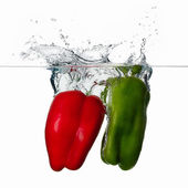 Fresh Red and Green Peppers Splash in Water Isolated on White Ba — Stock Photo