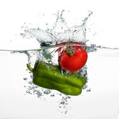 Fresh Tomato and Pepper Splash in Water Isolated on White Backgr — Stock Photo