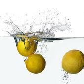 Fresh Lemons Splash in Water Isolated on White Background — Foto Stock