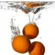 Fresh and Health Oranges Falling into Clean Water Isolated on Wh — Stock Photo
