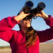Stock Photo: Ecologist WomWatching Environment with Binoculars
