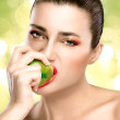 Beautiful Brunette Girl Biting an Apple — Stock Photo #44146003